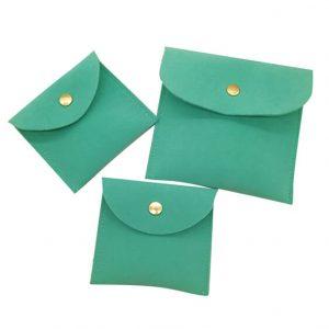 green envelop suede bag