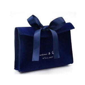 Dark blue suede jewelry bag with bow-knot