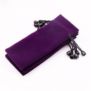 suede drawstring pouch with small bell
